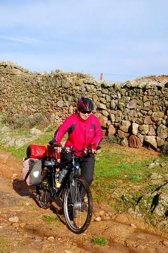 Friedel walking her bike