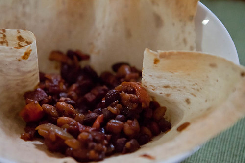 Homemade mixed baked beans in crispy mountain bread
