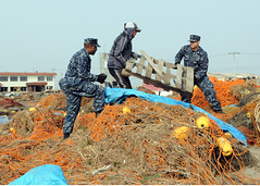 Sailors help remove debris from port of Misawa...