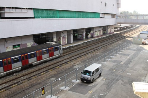 Goods yard at Sha Tin, EMU departs the adjacent passenger platform