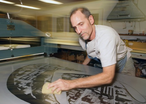 """Tom Pruitt works on """"Coco Solo"""", a print created by Los Carpinteros and produced at Graphicstudio."""