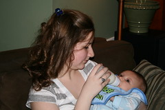 Tori feeding a friend's 2 month old son