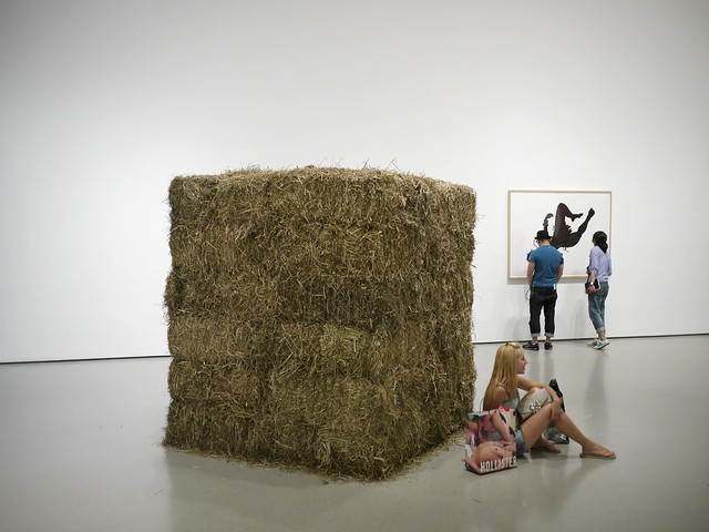 Girl with a Bale of Hay