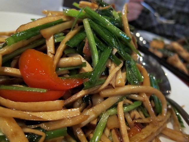 peter chang's - leek and smoked tofu with bamboo shoots closeup