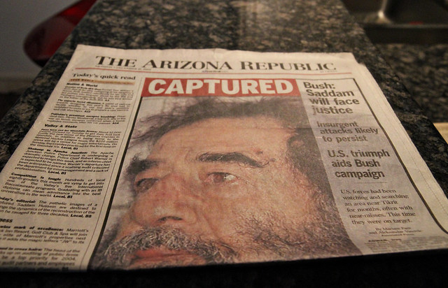 Saddam Hussein is captured - paper dated 12/15/03.