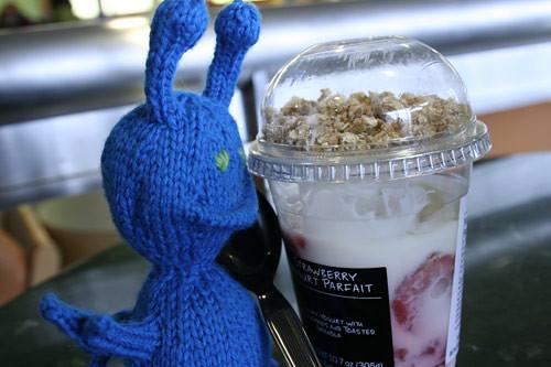 Bluelian grabbing a strawberry yogurt parfait