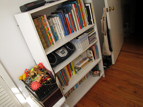 Project Simplify week 3 - Their bookshelves after