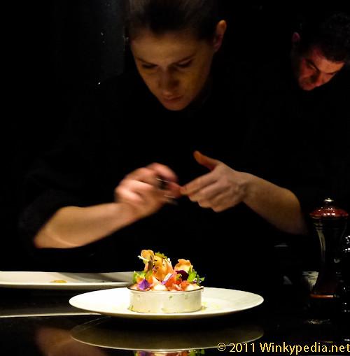 Our view at L'atelier de Joel Robuchon- chef preparing lobster salad