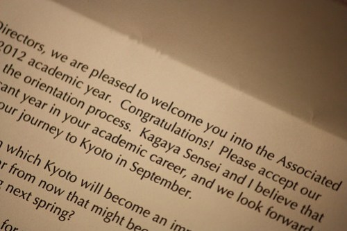 "Another photo of the letter, centered on the word ""Congratulations!"""