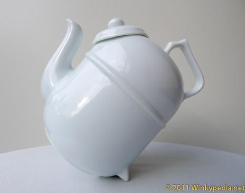 Tilting teapot- filtering position