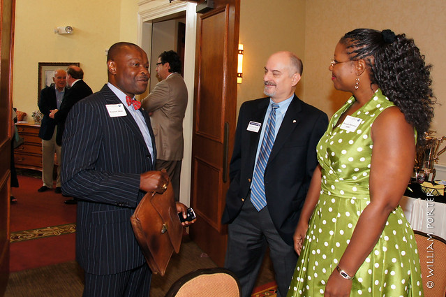 Dallas mayoral candidate Edward Okpa (left) schmoozes with guests at the Lakewood Country Club
