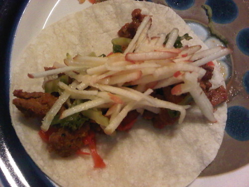 Spicy korean pork taco w apple-grapefruit slaw, pickled ginger and avocado