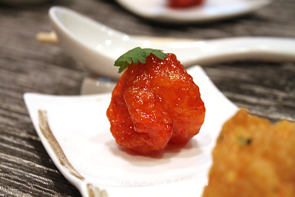 Golden Prawn tossed in Salted Egg Yolk, coasted with wasabi dressing served in Sweet and Sour Sauce