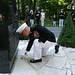 Gen. James F. Amos lays a commemorative coin in front of the Iron Mike monument in the heart of the Belleau Wood forest