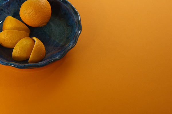A clementine in a blue bowl.
