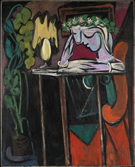 Picasso, Pablo  - Reading at a table   - 1934