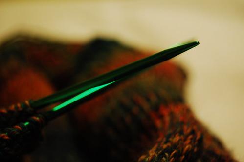 green needles, rainbow socks