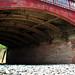 Old iron bridge across bright white stone