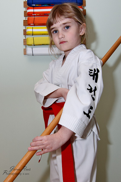 The little one prepares to practice her Jin Bo Staff form.