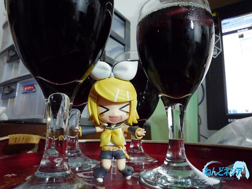Kagamine Rin celebrates the New Year drinking red wine