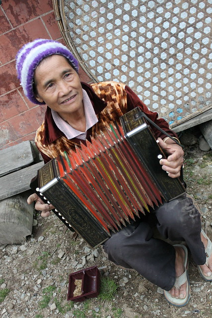 Old Lady playing the accordion in Benguet - 3