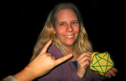 20101126 2339 - Carolyn - pentagram cookie, devil horns - IMG_2494