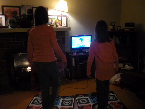 Rach and Essie playing Dance, Dance Revolution as twins.