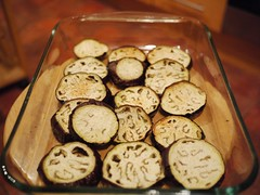 Layering aubergines on a baking dish
