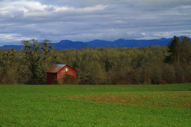 Old barn with Cascade Range in the background