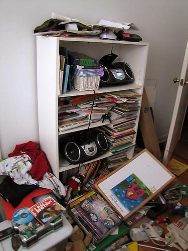 Project Simplify week 3 - Their bookshelves before