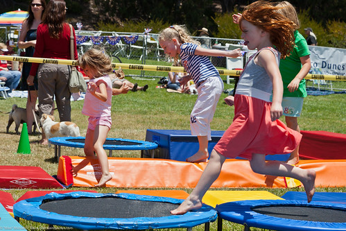 Kids on Trampolines. People at Morro Bay, CA Fourth of July 2011 Celebration