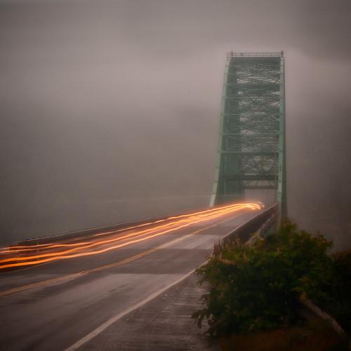 A bridge in morning fog