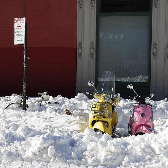yellow & pink Vespa's caught in a snow drift on Crosby St while not #walkingtoworktoday