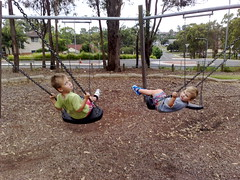 Two boys on swings