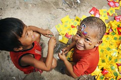 Children Play with Garbage in Cambodia Slum