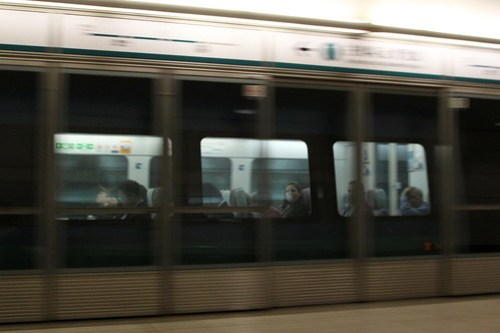Train arriving into Kowloon station - only a few passengers aboard the