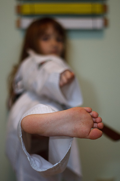 The big one displays the business side of her foot with a beautiful side kick.