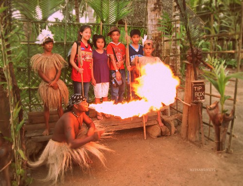 The man who blows fire: a stop over during the ride at the floating restaurant, Bohol
