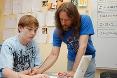 Article image: Freeport Middle School algebra teacher Alex Briasco-Brin works with a student.