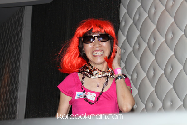 A participant playing dress up
