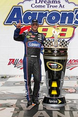 Jimmie Johnson celebrates at the Talladega Superspeedway in 2011