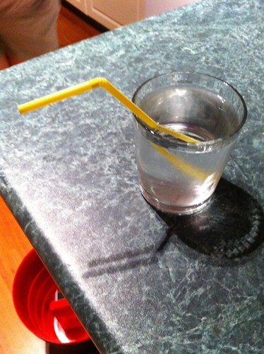 a glass of colonlytely, with straw