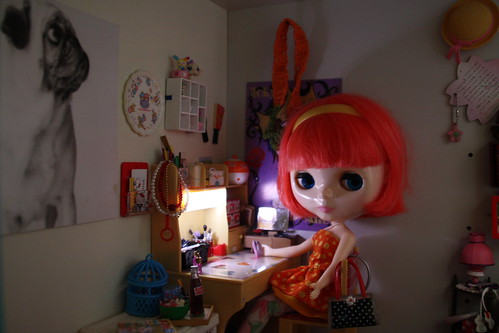 Bambi by her desk, about to make a phone call