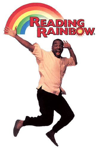 Reading Rainbow TV Show Host LeVar Burton Jumping With Logo