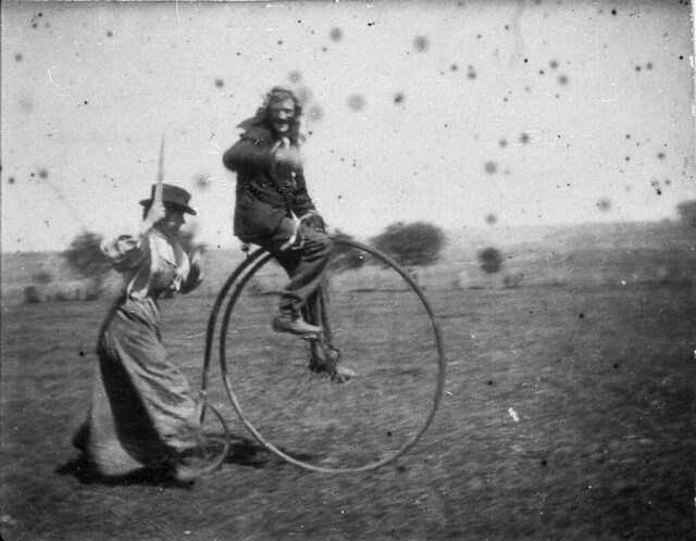 Man on a penny-farthing bicycle being chased by his sister (Maggie & Bob Spiers) - West Wyalong, NSW, C. 1900