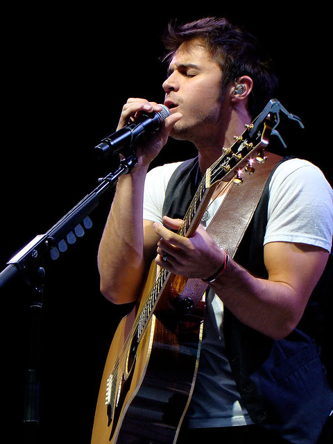 Kris Allen sexy UNF biceps arms blood veins neck closed eyes white tee shirt photo taken at Los Angeles Greek Theatre