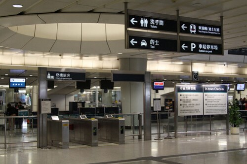 Ticket barriers outside the Kowloon station In Town Check In desks