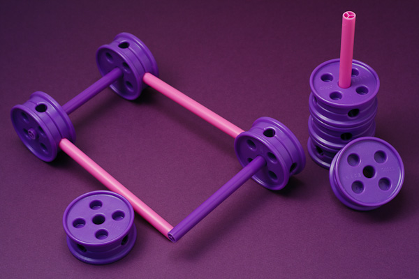 Purple and pink Tinker Toy chassis, under construction.
