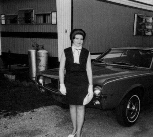 Woman, car, and trailer