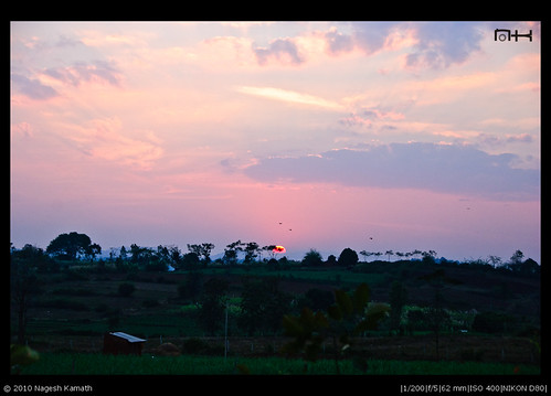 The sun sets on the outskirts of Kabini